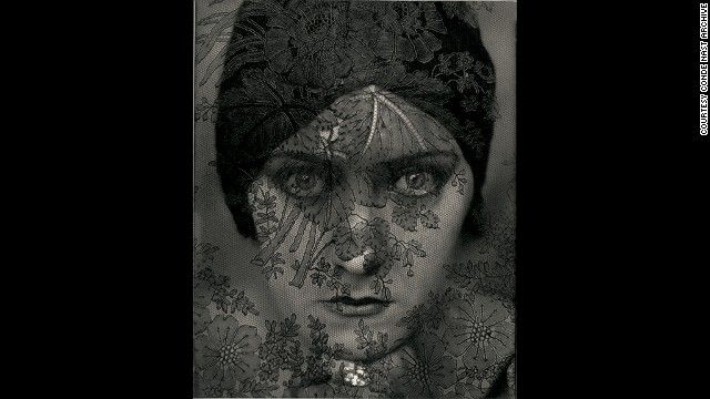 Actress Gloria Swanson in 1924, behind a laced veil.