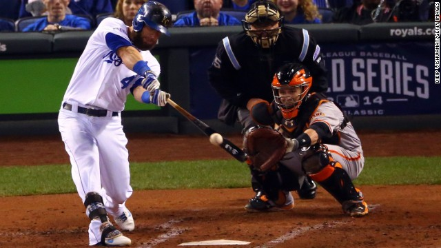Kansas City Royals third baseman Alex Gordon hits an RBI double in the second inning against the San Francisco Giants during Game 7 of the 2014 World Series at Kauffman Stadium on October 29 in Kansas City, Missouri.