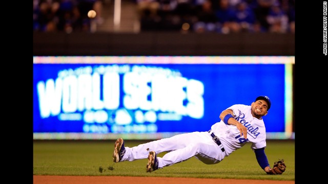 Kansas City Royals second baseman Omar Infante tries to make a play in the fourth inning against the San Francisco Giants during Game 7 of the 2014 World Series at Kauffman Stadium on October 29 in Kansas City, Missouri.