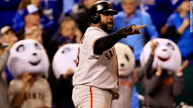 San Francisco Giants third baseman Pablo Sandoval celebrates after scoring in the fourth inning against the Kansas City Royals during Game 7 of the 2014 World Series at Kauffman Stadium on October 29 in Kansas City, Missouri.