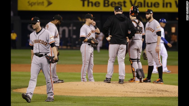 San Francisco Giants starting pitcher Tim Hudson, left, walks off the mound after being relieved during the second inning of Game 7 of the World Series on October 29 in Kansas City, Missouri.