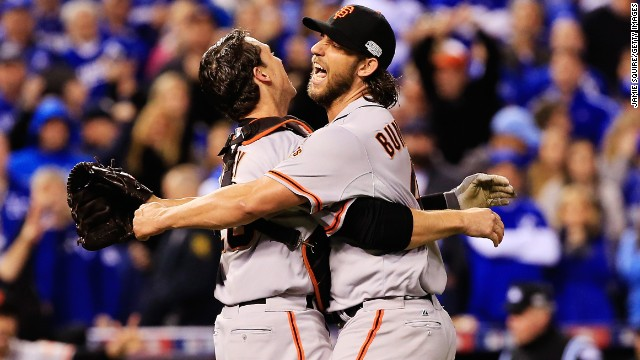 San Francisco Giants players Buster Posey, left, and Madison Bumgarner celebrate after defeating the Kansas City Royals 3-2 to win Game 7 of the 2014 World Series at Kauffman Stadium on October 29 in Kansas City, Missouri. Bumgarner was the series MVP.