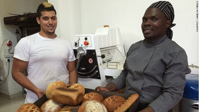 Kevin from Toulouse in France (left) works at the bakery and trains local staff like Pascal (right) how to make fresh bread.