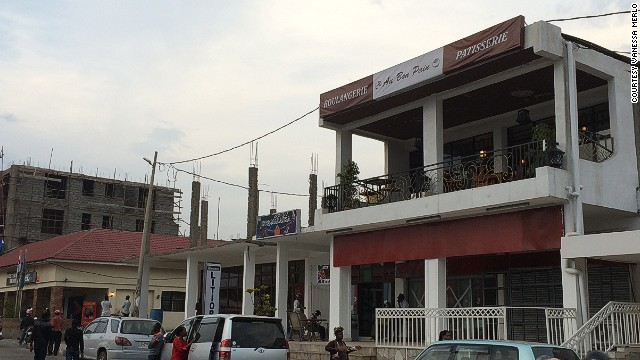 The bakery, which is located in central Goma, has a balcony on the second floor. Construction of new buildings in the city is continuing apace as the city rebuilds after violence and a nearby volcano erupted in 2002.