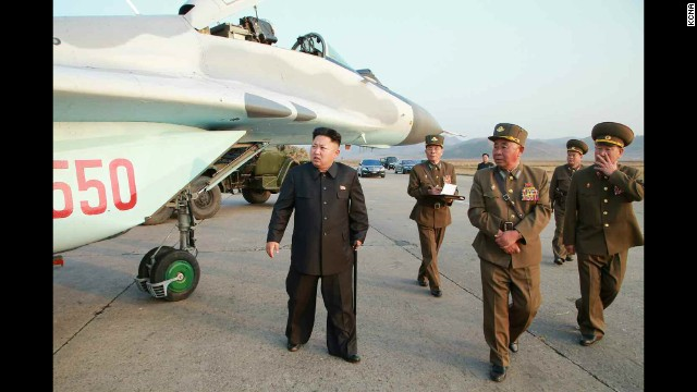 North Korean leader Kim Jong Un is seen walking with a cane in this image released Thursday, October 30, by the state-run Korean Central News Agency. Kim, who recently disappeared from public view for about six weeks, had a cyst removed from his right ankle, a lawmaker told CNN.