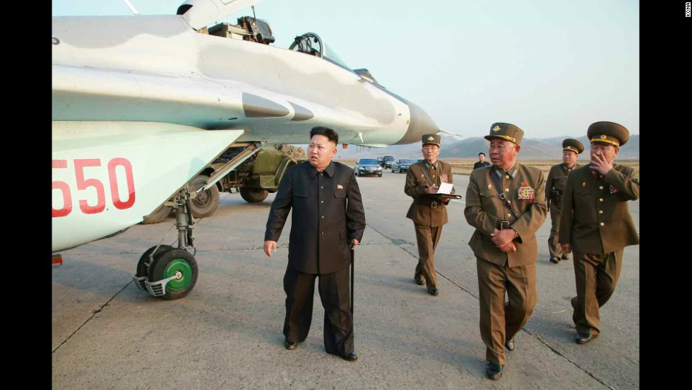 North Korean leader Kim Jong Un is seen walking with a cane in this image released Thursday, October 30, by the state-run Korean Central News Agency. Kim, who recently disappeared from public view for about six weeks, <a href='http://www.cnn.com/2014/10/28/world/asia/kim-jong-un-cyst/index.html'>had a cyst removed</a> from his right ankle, a lawmaker told CNN.