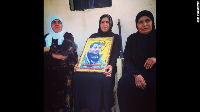 "KURDISH-CONTROLLED NORTHERN SYRIA: Grieving Kurdish mother in northern Syria clutches portrait of her son Mehyedin. She says he was a fighter in the People's Protection Units (YPG), killed 2 months ago battling ISIS in the border town of Rabiyah. ""I'm proud of my son,"" she says. The women next to her also lost children in the Kurdish war against ISIS. - CNN's Ivan Watson, October 30. Follow Ivan (<a href='http://instagram.com/ivancnn' target='_blank'>@ivancnn</a>) and other CNNers along on Instagram at <a href='http://instagram.com/cnn' target='_blank'>instagram.com/cnn</a>."