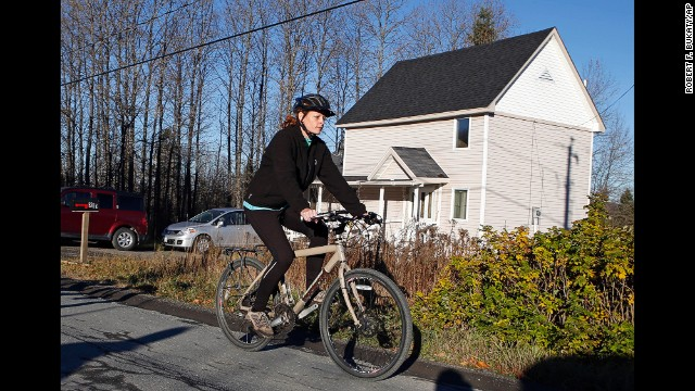 Kaci Hickox leaves her home in Fort Kent, Maine, to take a bike ride with her boyfriend on Thursday, October 30. Hickox, a nurse, recently returned to the United States from West Africa, where she treated Ebola victims. State authorities want her to avoid public places for 21 days -- the virus' incubation period. But Hickox, who has twice tested negative for Ebola, <a href='http://www.cnn.com/2014/10/30/health/us-ebola/index.html'>has said she will defy efforts</a> to keep her quarantined at home.