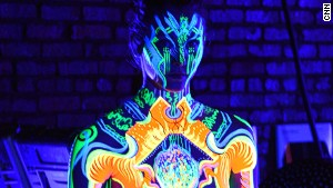 3-D neon bodypaint illuminates dancers