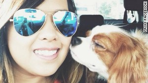 Nina Pham rides with her dog, Bentley, as seen in this photo from Facebook. After Pham\'s treatment for Ebola and Bentley\'s quarantine, the two were reunited Saturday.