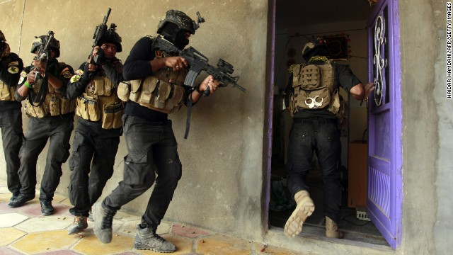 Iraqi special forces search a house in Jurf al-Sakhar, Iraq, on October 30 after retaking the area from ISIS.