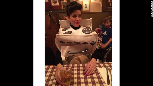 "Liv Tyler dressed as a stove. She wrote on her <a href='http://instagram.com/p/uwa8QVQQQZ/?utm_source=partner&utm_medium=embed&utm_campaign=photo&modal=true' target='_blank'>Instagram </a>that she has a ""Bun in my oven..."""