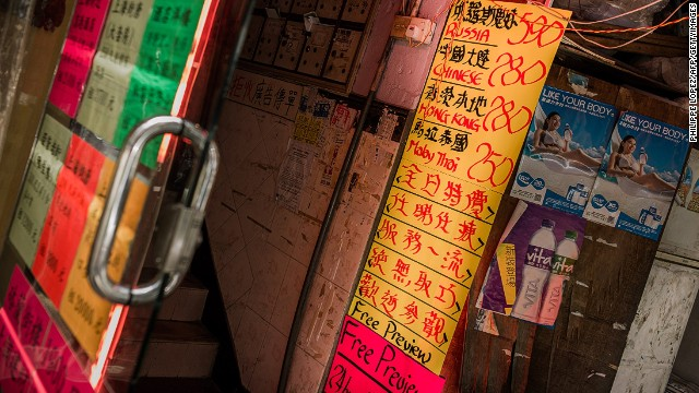 A file image of a sign in Wan Chai shows prices for prostitutes of varying nationalities.