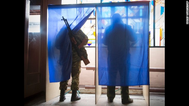 Pro-Russian rebels fill out ballots at a polling station during rebel elections in Donetsk, Ukraine, on Sunday, November 2. Moscow has said it will recognize the results of the vote in the provinces of Donetsk and Luhansk, while the government in Kiev, the United States and European Union have condemned the elections as illegitimate.