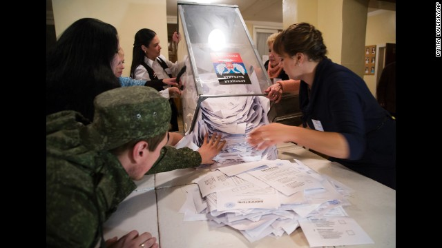 Election officials empty a ballot box in Donetsk on November 2.