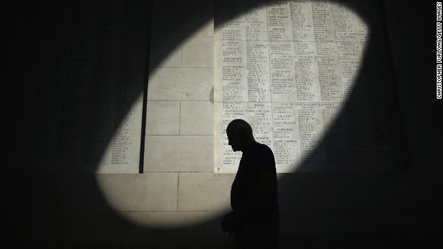 A shaft of sunlight falls on the names of the missing at the Menin Gate Memorial on the centenary of the Great War in Ypres, Belgium.