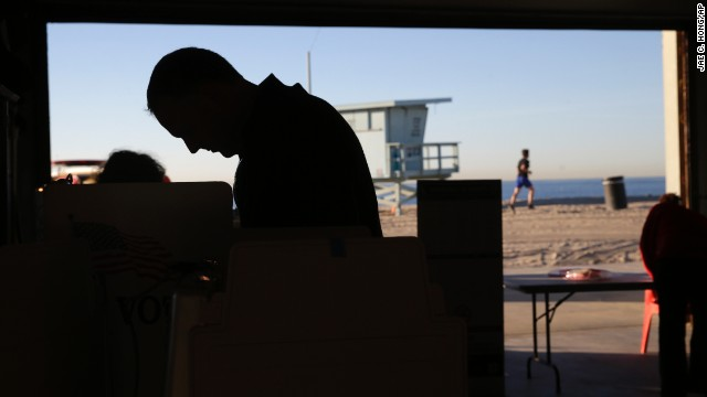 A voter casts his ballot at a polling place set up at the Venice Beach lifeguard headquarters in Los Angeles.