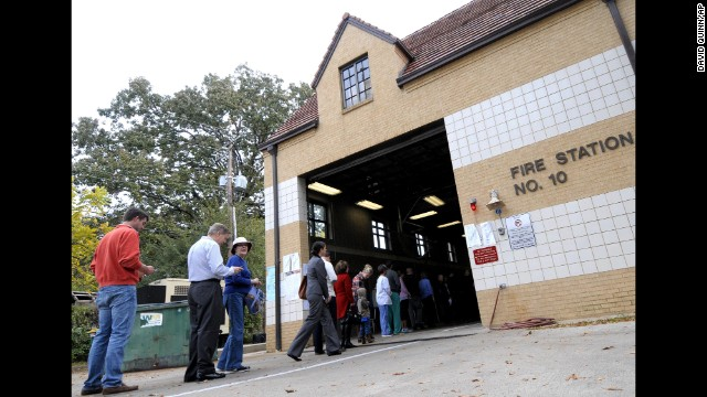 Arkansas voters wait to cast their ballots at a Little Rock fire station on Election Day.