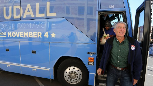 Udall exits his campaign bus during an Election Day visit to the University of Colorado in Boulder, Colorado.