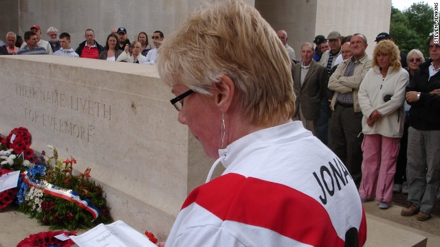 Theresa Burns, wearing a Clapton Orient shirt with the surname of Jonas, the former Orient player, on the back, reads a poem in homage to the fallen.