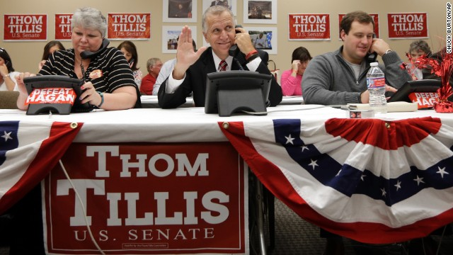 Tillis waves to a supporter as he makes calls at his campaign office in Cornelius on November 3.