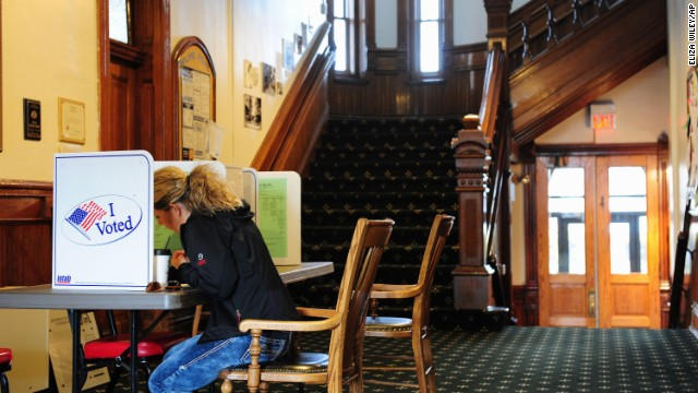 Samantha Mongoven casts her vote in the hallway of the historic courthouse in Boulder, Montana, on Tuesday, November 4. Millions of people nationwide are taking part in the 2014 midterm elections.