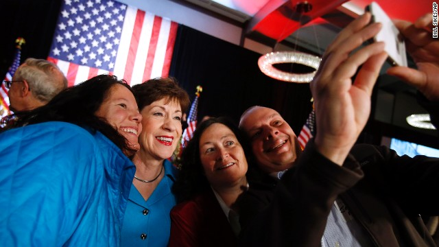 U.S. Sen. Susan Collins poses for a selfie with supporters while celebrating her re-election victory in Portland, Maine.