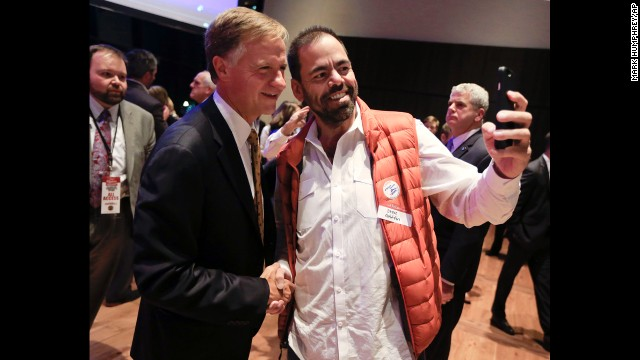 Tennessee Gov. Bill Haslam poses for a photo with supporter Steve Griffin, right, after Haslam was re-elected.