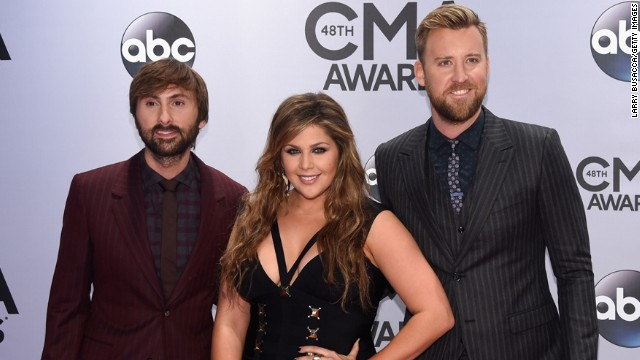 Dave Haywood, Hillary Scott, and Charles Kelley of Lady Antebellum attend the 48th annual CMA Awards at the Bridgestone Arena on Wednesday, November 5, in Nashville.