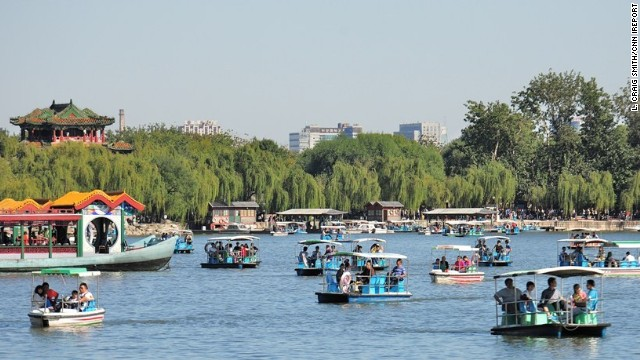 Colorful boats float along a lake at the<a href='http://ireport.cnn.com/docs/DOC-850856'> Summer Palace </a>in Beijing, China. The historic site, which was <a href='http://whc.unesco.org/en/list/880' target='_blank'>restored in 1886</a> after being ravaged by war, is dotted with beautiful gardens, pavilions and temples.