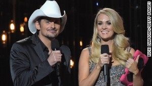 Hosts Brad Paisley and Carrie Underwood onstage.