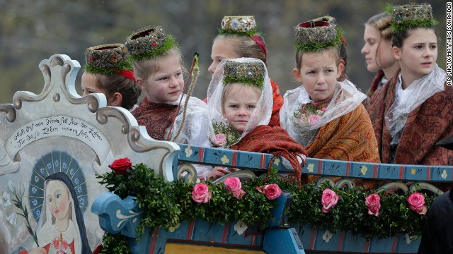 NOVEMBER 6 - BAD TÖLZ, GERMANY: Girls in traditional costume sit in a horse-drawn carriage during the annual Leonhardi pilgrimage. The event honors St. Leonhard, patron saint of the highland farmers for horses and livestock.