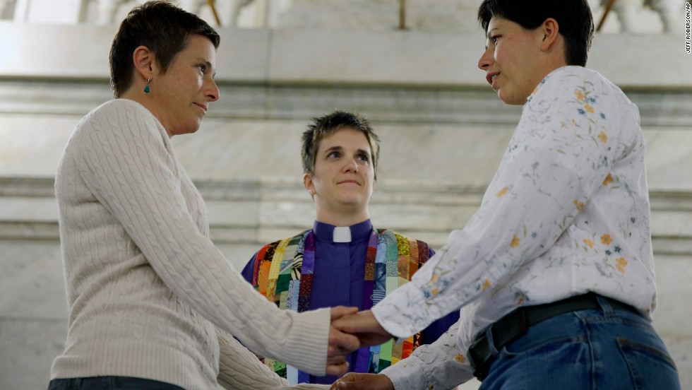 April Dawn Breeden, left, and longtime partner Crystal Peairs are married by the Rev. Katie Hotze-Wilton at St. Louis City Hall on Wednesday, November 5. A Missouri judge on November 5 overturned the state's ban on same-sex marriages and ordered registrars to start issuing licenses to gay and lesbian couples. More than 30 states and the District of Columbia allow marriage for same-sex couples.