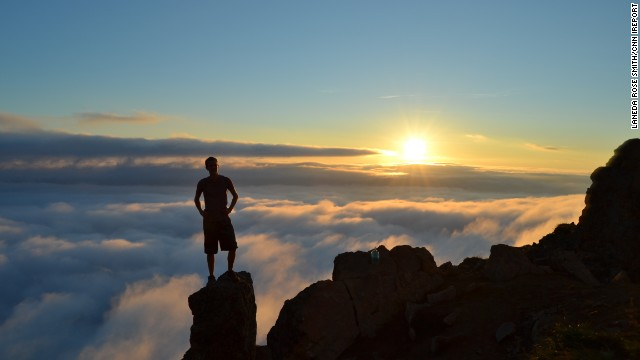 "Laneda Rose Smith photographed this stunning image of her friend, Patrick, standing on Flattop Mountain in Anchorage, Alaska, at sunset. ""Being above the clouds while not in an airplane was one of the most remarkable things I have ever witnessed."""