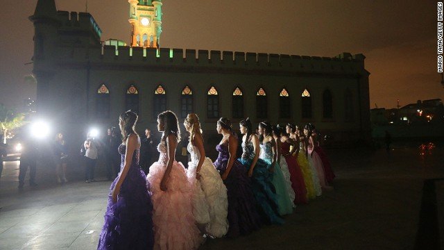 NOVEMBER 7 - RIO DE JANEIRO, BRAZIL: Teenage girls from the Cerro-Cora favela (slum) pose before the start of their debutante ball at the Ilha Fiscal castle in Guanabara Bay, organized by the Pacifying Police Unit (UPP) from their community on November 6. The gala relied on volunteers who prepared makeup, styled hair and loaned dresses, in an effort to build goodwill between residents and the community's police force.
