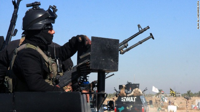 Iraqi military forces take up position in Jurf al-Sakher, south of Baghdad, on November 8.