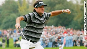 Bubba Watson produced two moments of magic on the 18th green to win the WGC-HSBC tournament in Shanghai.