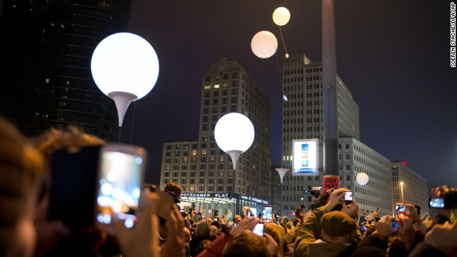 Balloons from the art installation Lichtgrenze 2014 fly away at Potsdamer Platz to commemorate the fall of the wall in Berlin, Germany, on Sunday, November 9. The art installation featuring 8,000 luminous white balloons commemorates the division of Berlin by marking the path the wall once followed.