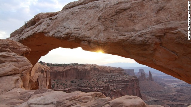 "<a href='http://ireport.cnn.com/docs/DOC-1035615'>Deepak Yalamanchi</a> and his friends were rewarded for their hourlong wait at Mesa Arch in Utah's Canyonlands National Park with this beautiful sunrise. ""It filled the place with a brilliant golden hue that was breathtaking!"" he said."