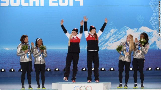 Meyers Taylor's friend, Kaillie Humphries, piloted a Canadian sled to gold ahead of her at Sochi 2014. Humphries would be a guest at the Taylors' wedding two months later.