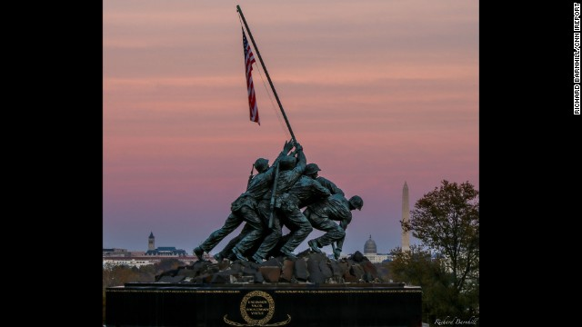 "As the sun set around Washington, D.C., <a href='http://ireport.cnn.com/docs/DOC-1187523'>Richard Barnhill </a>caught this shot of the Marine Corps War Memorial against the pink fall sky. The<a href='http://www.nps.gov/gwmp/historyculture/usmcwarmemorial.htm' target='_blank'> Marine Corps War Memorial</a> inscription reads: ""In honor and in memory of the men of the United States Marine Corps who have given their lives to their country since November 10, 1775."""