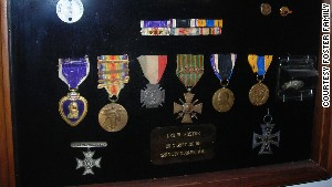 A shadowbox contains Leo Foster\'s medals earned during his service in World War I.