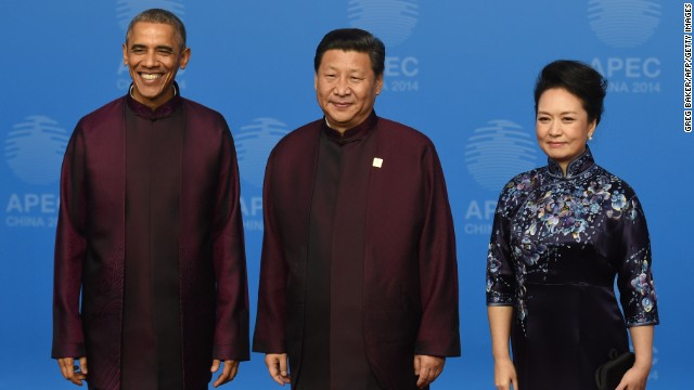 """U.S. President Barack Obama poses with Chinese President Xi Jinping and his wife Peng Liyuan as they arrive for the APEC summit banquet November 10, 2014. Each year, APEC leaders dress up in the the host country's traditional garb for a """"family photo"""" -- it's also been called the """"silly shirts photo."""""""