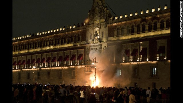 Protesters set fire to the main entrance of the Mexican National Palace during a demonstration in Mexico City on Saturday, November 8.