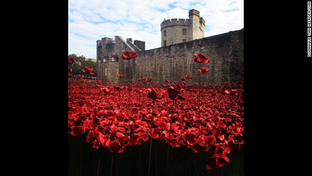 "LONDON: ""Take a moment to remember someone, somewhere sacrificed something."" - CNN's Dominique Van Heerden, November 11. Wrapped in heavy coats against the November chill, thousands of visitors crowd onto the paths circling the Tower of London to catch a glimpse of the extraordinary ""sea"" of crimson filling the castle's moat below. The blood-red tide which flows from one of the palace's windows and laps at its ancient stone walls is made of hundreds of thousands of individually handcrafted ceramic poppies. Each of the 888,246 blooms in the artwork, ""Blood Swept Lands and Seas of Red,"" represents a life lost in World War I -- one for each of the British and Colonial soldiers killed in the conflict that began 100 years ago. <a href='http://edition.cnn.com/2014/11/07/world/europe/tower-of-london-poppies/index.html?hpt=wo_c2'>FULL STORY AT CNN.COM</a>. Follow Dominique (<a href='http://instagram.com/dominiquecnn' target='_blank'>@dominiquecnn</a>) and other CNNers along on Instagram at <a href='http://instagram.com/cnn' target='_blank'>instagram.com</a>."