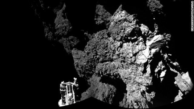 Rosetta's lander Philae is on the surface of Comet 67P/Churyumov-Gerasimenko on Thursday, November 13, and sending back images. One of the lander's three feet can be seen in the foreground. While Philae is the first probe to land on a comet, Rosetta is the first to rendezvous with a comet and follow it around the sun. The information collected by Philae at one location on the surface will complement that collected by the Rosetta orbiter for the entire comet.
