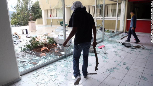 Protesters damage the headquarters of the Institutional Revolutionary Party on November 12 in Morelia, Mexico. The Iguala incident has sparked protests across Mexico.