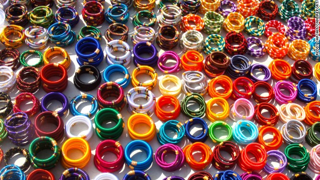 <a href='http://ireport.cnn.com/docs/DOC-1182176'>Colorful bangles</a> fill a street vendor's table in Jaipur, India.