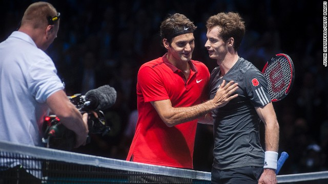 Roger Federer consoles Andy Murray after the Swiss blew the Scot away in a virtuoso display.