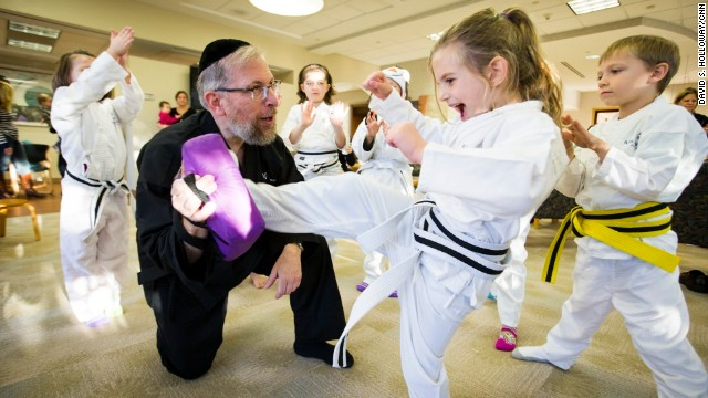 After witnessing the pain and fear that children with cancer endure, Rabbi Elimelech Goldberg founded a program that provides free martial arts classes so kids can learn to control their pain and feel powerful.